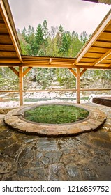 Open air bath outdoors in winter. Iron tub for bathing in hot water.