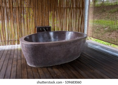 Open air bathroom, Marble bathtub with Bamboo backdrop and Wooden floor