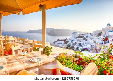 Open Air Cosy Restaurant in Beautiful Oia Village on Santorini Island in Greece Straight Before the Sunset.Horizontal image Composition