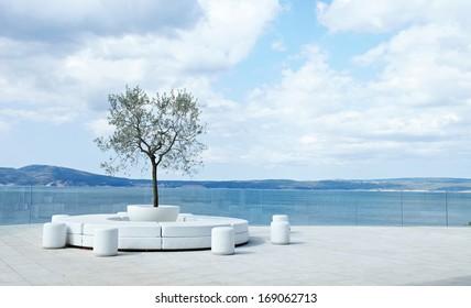 Open air lounge area with beautiful sea skyline
