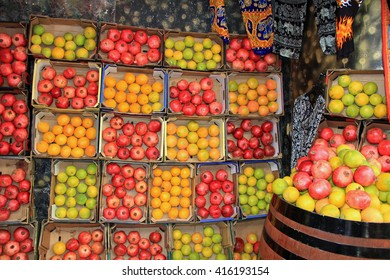 An open air market stall with oranges and pomegranates in the Christian quarter of Old Jerusalem, Israel.  Also known as the Muristan.