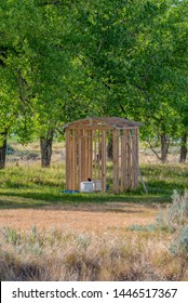 Open air outhouse with toilet in Saskatchewan, Canada: outhouse under construction