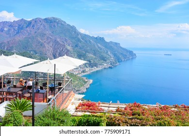 Open air street restaurant with umbrellas in Ravello village, Tyrrhenian sea, Amalfi coast, Italy