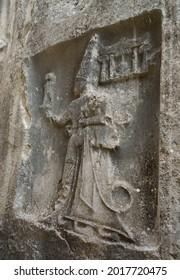 Yazılıkaya Open Air Temple Rock figures. Yazilikaya, Chamber B, King Tudhaliya is shown in the embrance of the god Sharuma, son of the storm god Teshup. Corum, Turkey