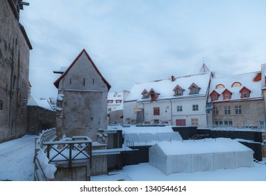 Open air theater and the narrow street. Snowy old town of Tallinn