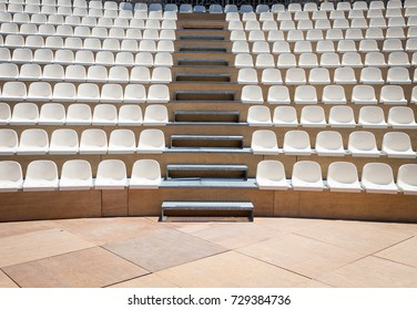 Open air theater with natural daylight; plastic seat rows