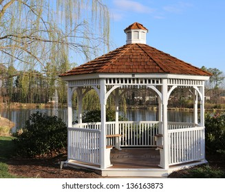 Open air wooden gazebo overlooking a pond an ideal place for picnics, photo shoots and engagement pictures