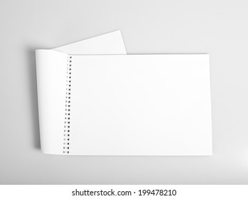 Open album with blank white pages mockup
