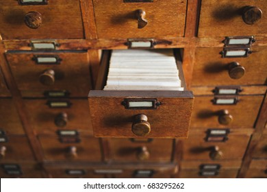 Open archive drawer. Wooden file catalog drawer. Concept for archive, database, catalog, library