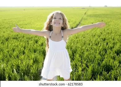 open arms little happy girl green meadow rice field