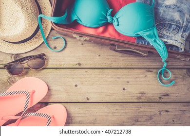 Open bag with beach or summer clothes