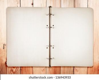 Open bank white notebook on Oak wood background