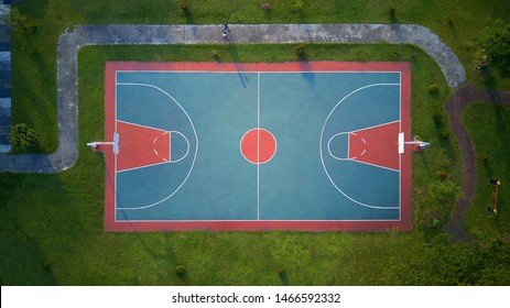 The open basketball court in park. Aerial Drone top view .