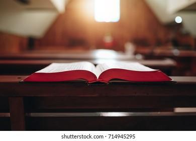 Open bible book on desk in church