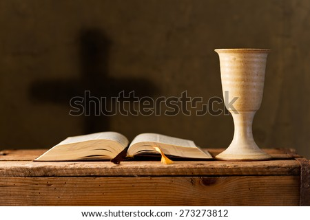open bible with chalice of wine in the church,selective focus