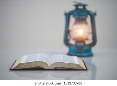 Open bible on desk,reading a book