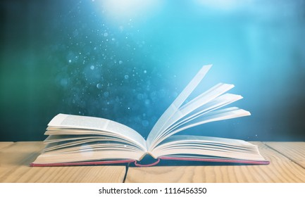 Open bible on wooden desk