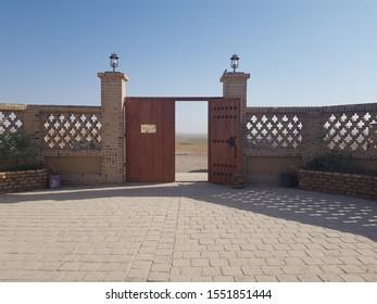 An open big door in the desert of Namakzar in Iran