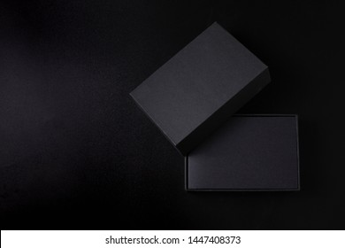 The open black box is placed on a black background.