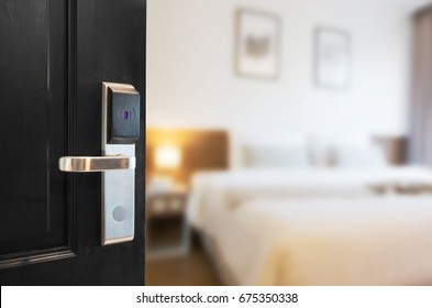 Open the black door using a key card system.