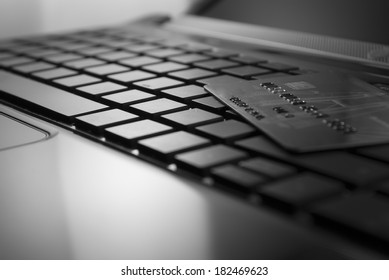 open black laptop and credit card on keyboard