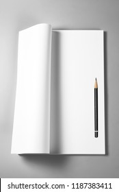 Open blank book, magazine, diary, or sketching book with pencil