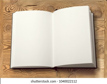 Open blank book on wood background
