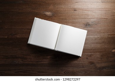 Open blank book on wooden background. Flat lay.