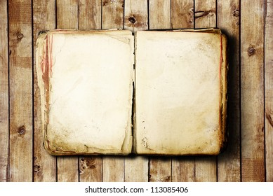 Open Book blank on old wooden background