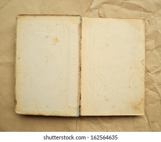 Open Book blank on old background