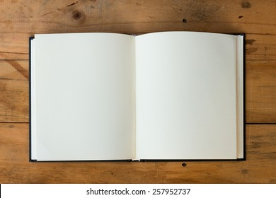 open book with blank pages on wood table