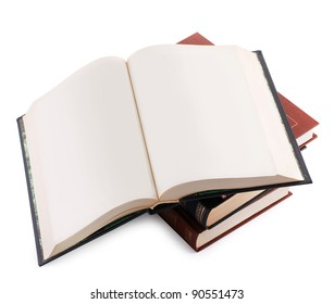 open book with blank pages on a pile of books on a white background