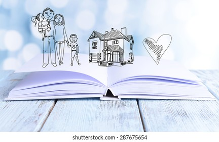 Open book with drawings on light background