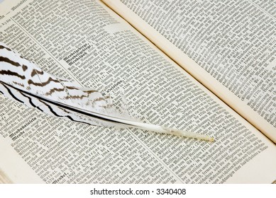 open book and feather