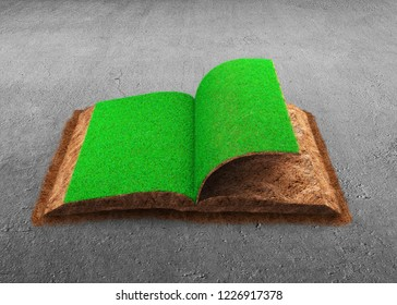 Open book of green grass and soil textured, on concrete floor background, concept of ECO, renewable energy and circular economy.