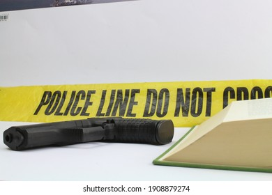 open book with a hand gun standing for crime books and thriller
