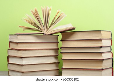 Open book, hardback books on wooden table. Back to school. Copy space for text.Education concept.