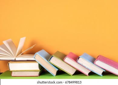 Open book, hardback books on bright colorful background. Back to school. Copy space for text
