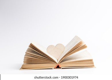 open book with heart symbol inside. love reading concept. valentine day greeting card conceptual.