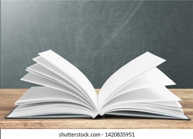 Open book isolated on white and letters