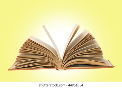 Open book  isolated on yellow background