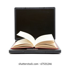 The open book laying on the laptop isolated on white