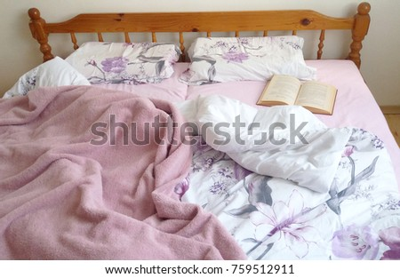 An Open Book Left On A Messy Bed, Old Book On A Bed With Floral