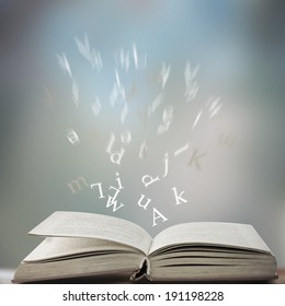 open book with letters