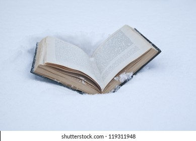 open book lying in the fresh snow drifts