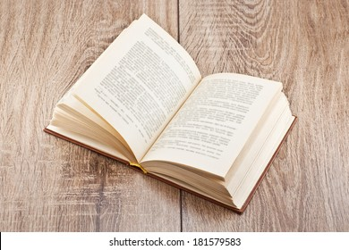 open book lying on a wooden table