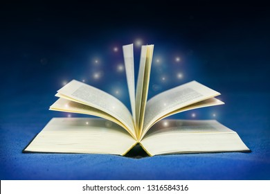Open book with magic light effects