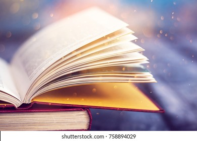 Open book with magic lights. Concept of wisdom, religion, reading, imagination, winter holidays