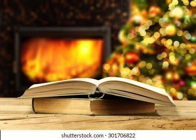 open book on big book on wooden board and xmas tree