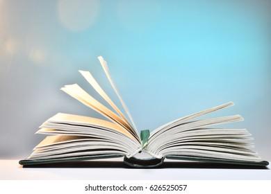Open book on a blue background.